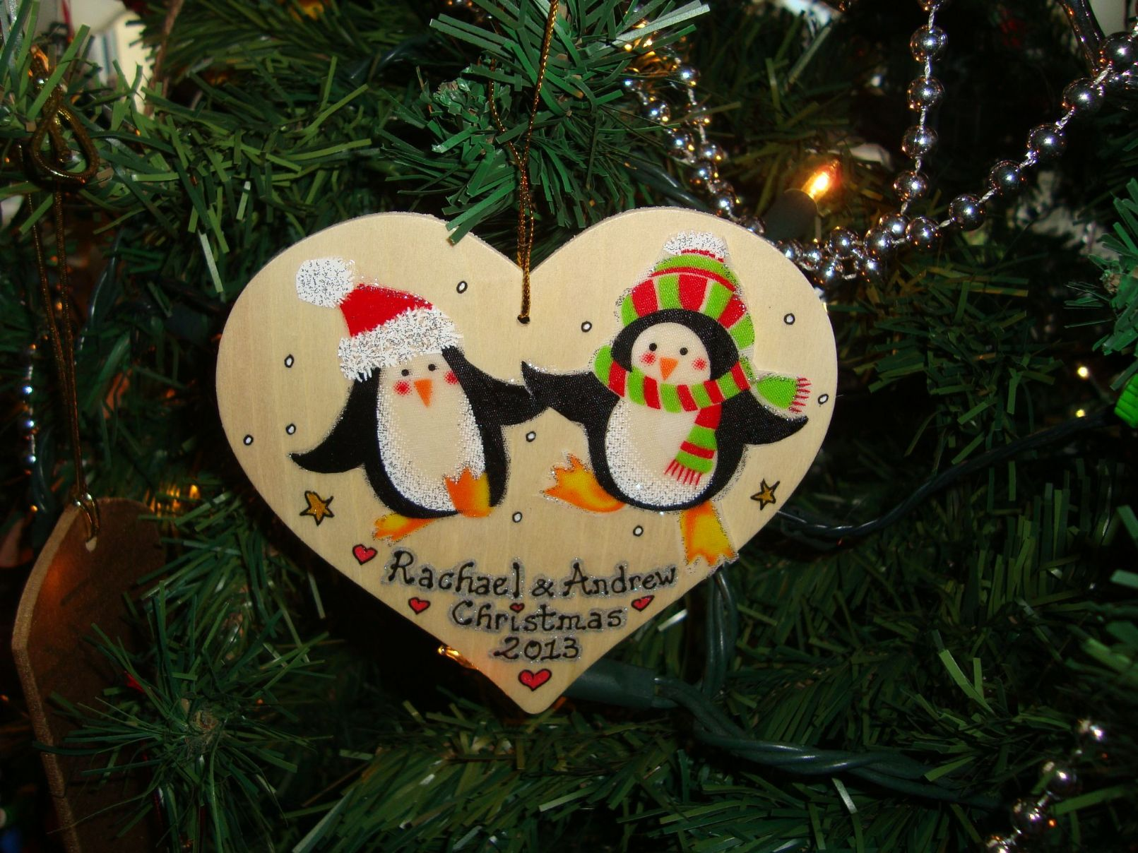 Penguin man lady couple wooden christmas heart hanger for Decoration names for christmas